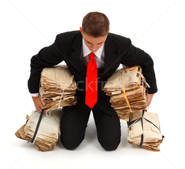 Tired businessman with lots of paperwork Stock photo © erierika
