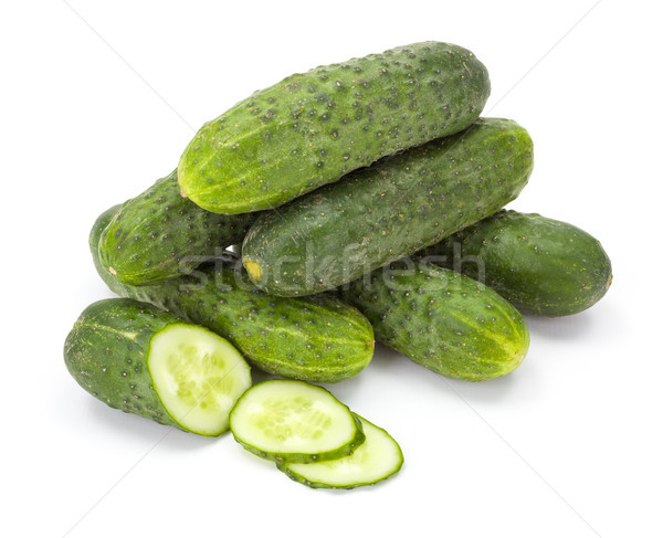 Pile of whole and sliced cucumbers (Cucumis sativus) Stock photo © erierika