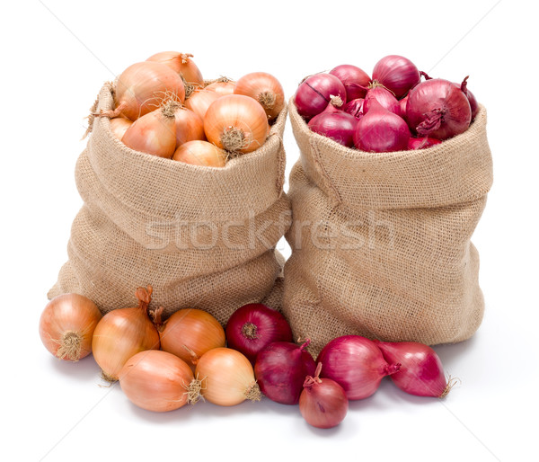 Red and yellow onions in burlap sack Stock photo © erierika
