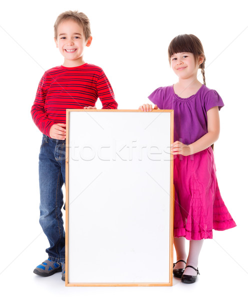 Cute girl and boy showing blank ad Stock photo © erierika