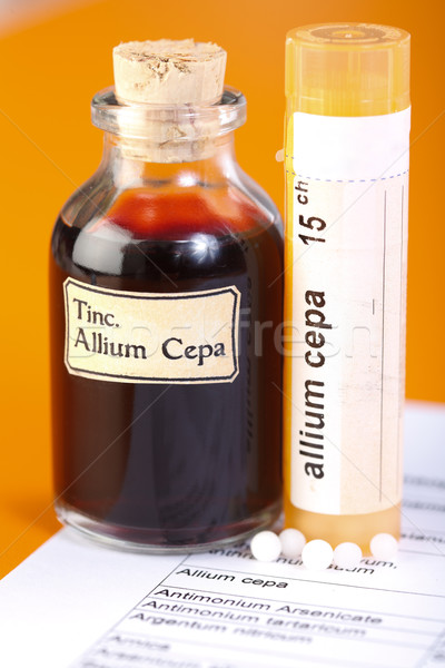 Allium Cepa plant extract, homeopathic pills on sheet Stock photo © erierika