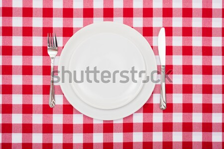 Empty white plates on checkered tablecloth Stock photo © erierika