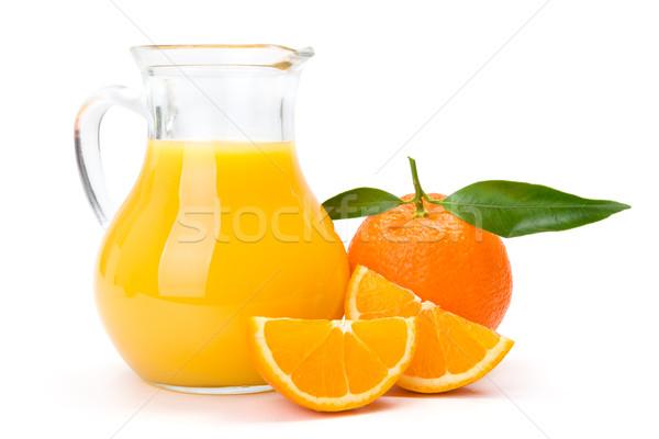 Narancs kancsó dzsúz érett friss gyümölcs Stock fotó © erierika