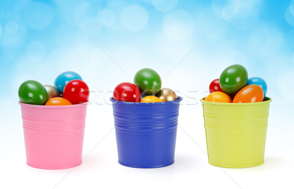 Colorful tin pails with Easter eggs Stock photo © erierika