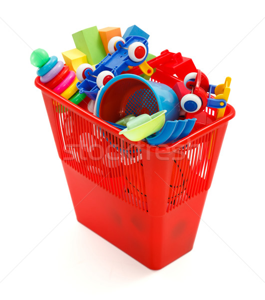 Stock photo: Lots of plastic toys thrown in garbage bin