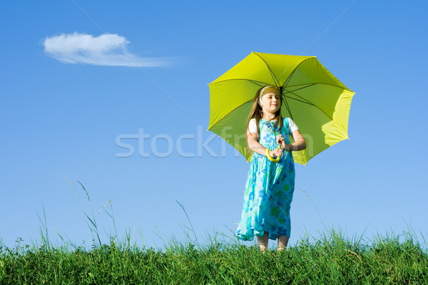 Girl at meadow with umbrella Stock photo © erierika