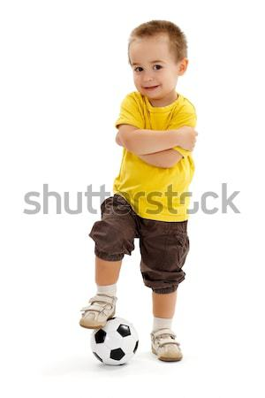 Little soccer player boy with small ball Stock photo © erierika