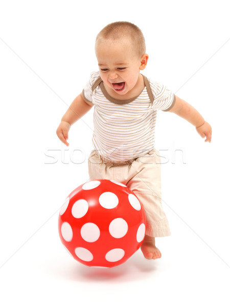 Little boy playing with red ball Stock photo © erierika