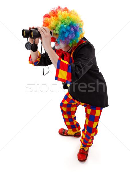Clown searching with binoculars Stock photo © erierika
