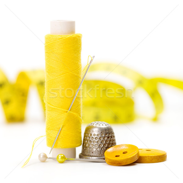 Sewing accessories: thread, needle and thimble Stock photo © erierika