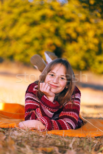 Cute girl in autumn, laying outdoors Stock photo © erierika