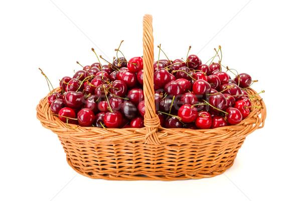 Sweet cherries (Prunus avium) in wicker basket Stock photo © erierika