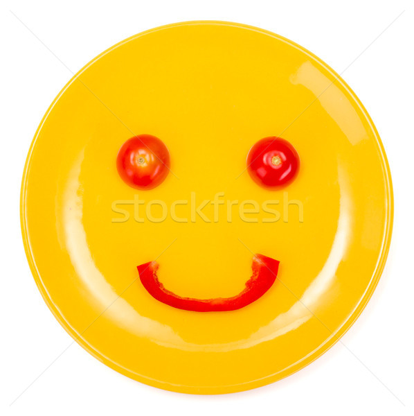Happy smiley face made on plate Stock photo © erierika