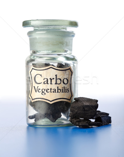 Carbo Vegetabilis, pure carbon in bottle and pieces Stock photo © erierika