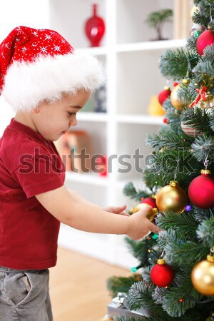 Little boy decorating Christmas tree Stock photo © erierika