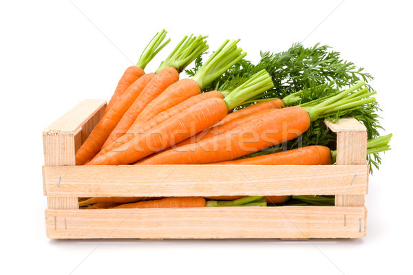 Carrot roots (Daucus carota ssp. sativus) in wooden crate Stock photo © erierika