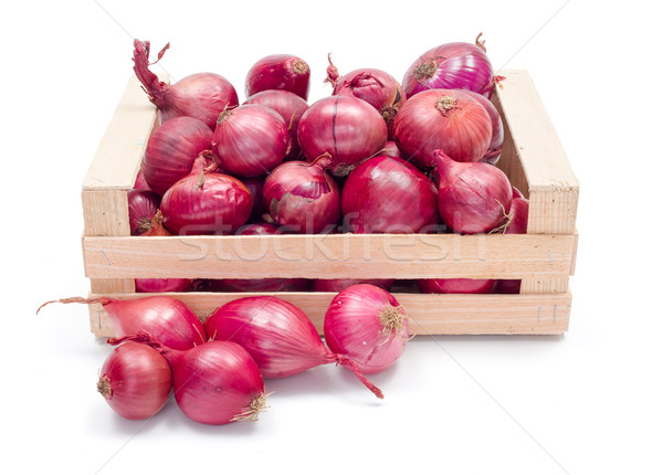 Red onions in wooden crate Stock photo © erierika