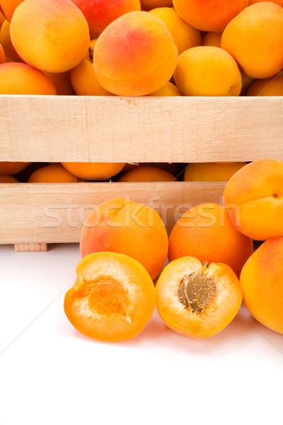 Macro of fresh peaches (Prunus persica) in wooden crate Stock photo © erierika