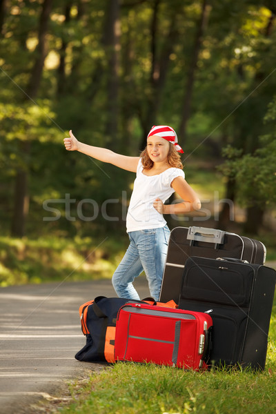 Stock photo: Young hitch-hiker girl