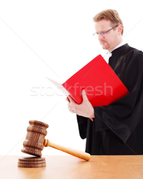 Stock photo: Justice gavel, judge reading in back