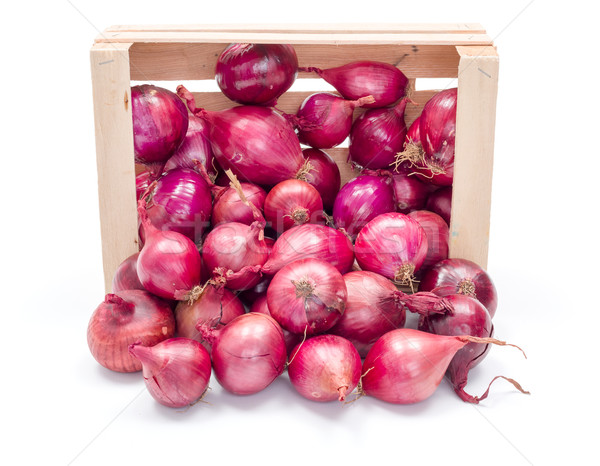 Red onion bulbs in wooden crate Stock photo © erierika