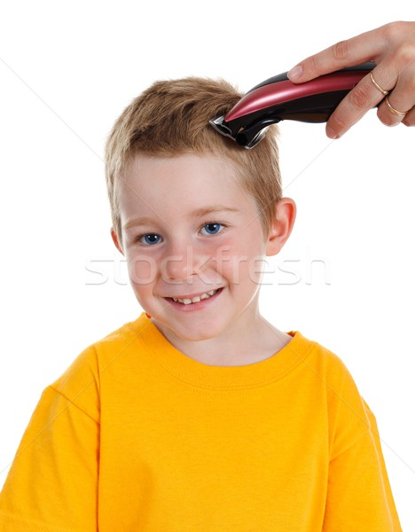 Smiling boy getting haircut Stock photo © erierika