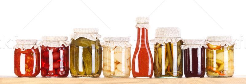 Various preserves on a wooden shelf  Stock photo © erierika