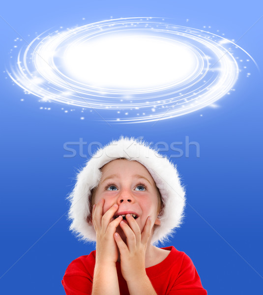 Surprised boy looking up to object placeholder Stock photo © erierika