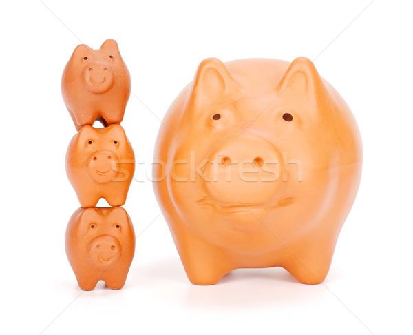 Small piggy banks superimposed near big one Stock photo © erierika