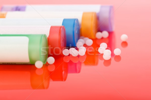 Színes homeopatikus tabletták piros tükröződő labda Stock fotó © erierika