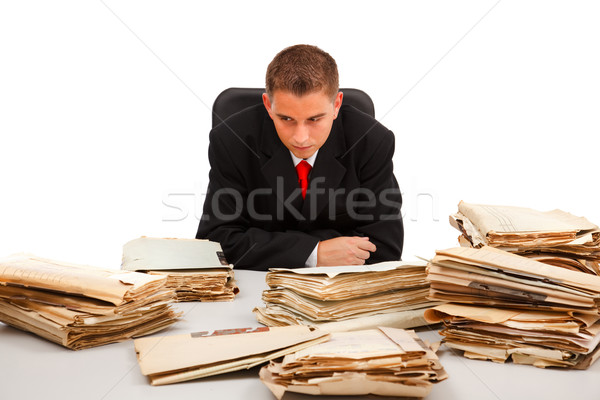 Man looking at lots of documents Stock photo © erierika