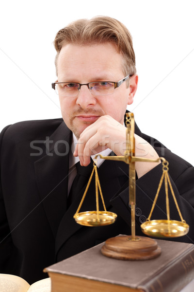 Serious attorney with golden scale Stock photo © erierika