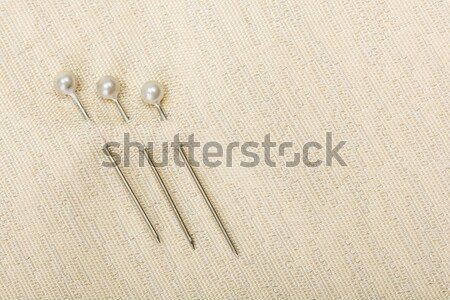 Pin inserted in fabric Stock photo © erierika