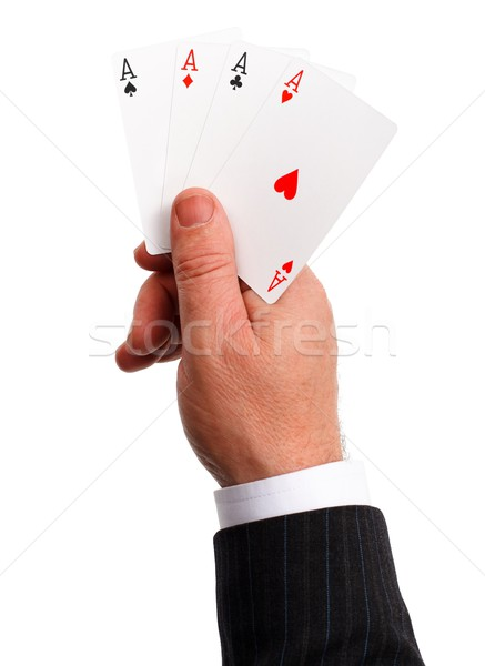 Man's hand holding aces Stock photo © erierika
