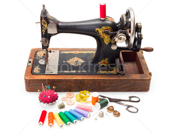Old sewing machine and accessories Stock photo © erierika