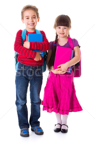 Cute little schoolgirl and schoolboy Stock photo © erierika