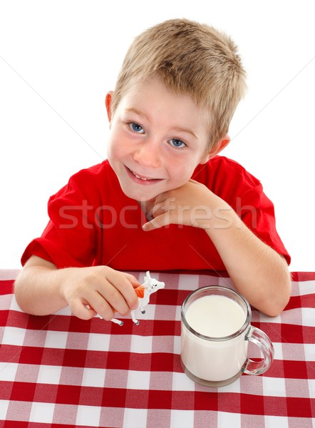 Young kid playing with toy cow near glass of milk Stock photo © erierika