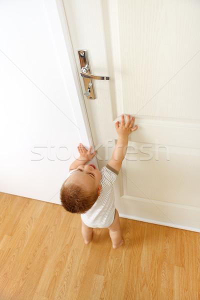 Baby in front of door Stock photo © erierika