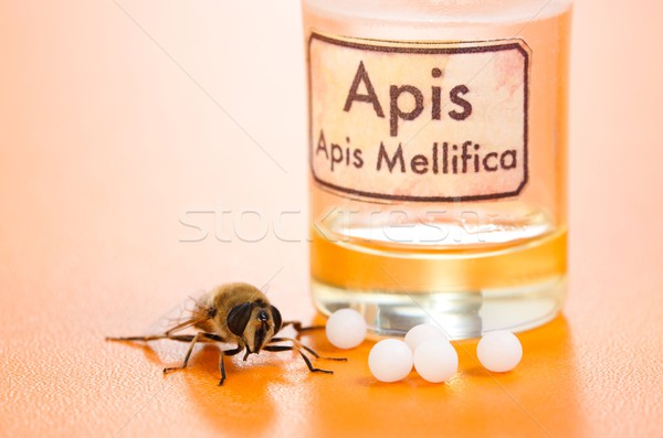 Apis Mellifica homeopathic pills, poison and bee Stock photo © erierika
