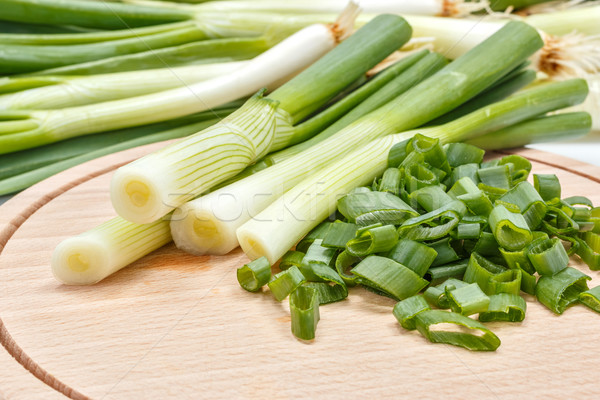 Freshly cut scallion on cutting board Stock photo © erierika