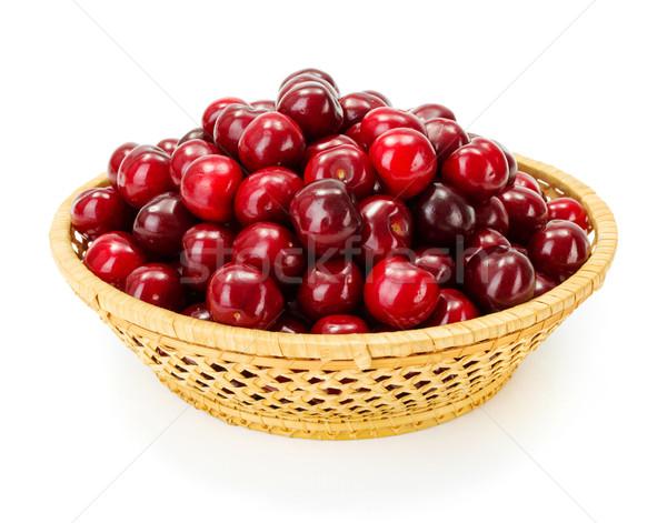 Sweet cherry berries (Prunus avium) in wicker plate Stock photo © erierika