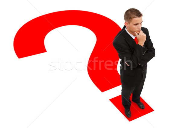 Businessman standing on question mark Stock photo © erierika