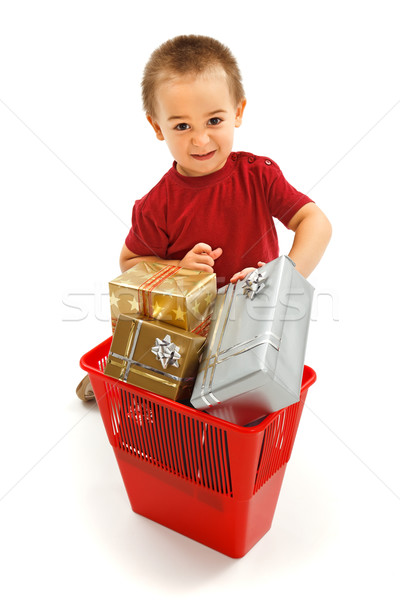 Little boy throwing presents in garbage bin Stock photo © erierika