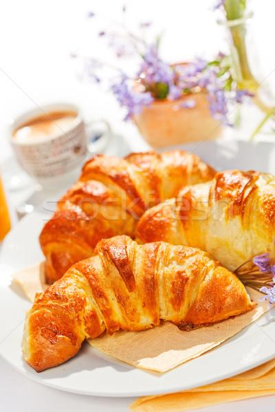 Croissantok tányér friss vaj reggeli asztal Stock fotó © erierika