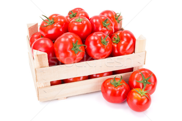 Tomatoes (Solanum lycopersicum) in wooden crate Stock photo © erierika