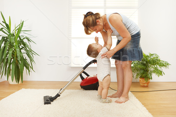 Mother cleaning the floor Stock photo © erierika