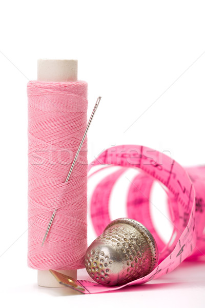 Stock photo: Sewing accessories: thread, needle and thimble