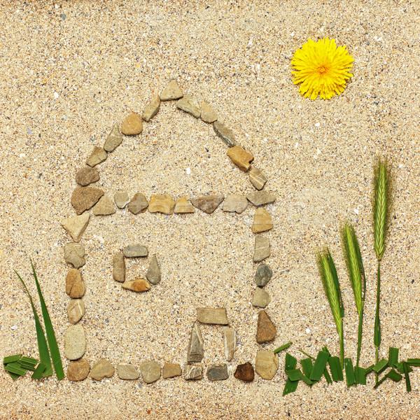 Stone house illustration in sand Stock photo © erierika