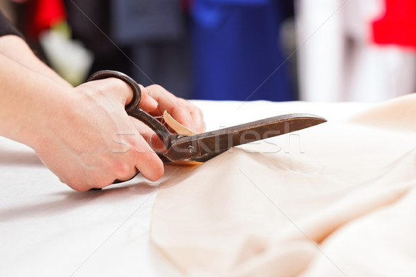 Cutting fabric with big old steel scissors Stock photo © erierika