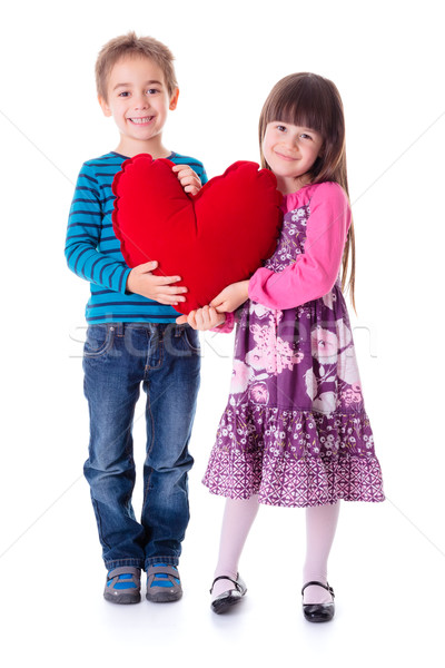 Girl and boy holding a big red heart shaped pillow Stock photo © erierika